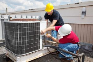 air-conditioning-service-technicians-working-on-a-unit